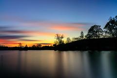 Farbreicher Sonnenuntergang (Giuseppe Caponio) Tags: abendrot bäume frühling landschaft langzeitbelichtung ndfilter see sonne sonnenuntergang wind wolken blauestunde oberuzwil kantonstgallen schweiz