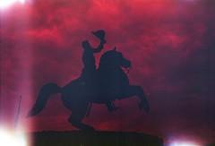 (von8itchfisk) Tags: film filmisnotdead ishootfilm redscale selfdeveloped tetenal c41 mediumformat 120film analog sculpture horse jacksonsquare neworleans vonbitchfisk moscow2 analogphotography lightleak