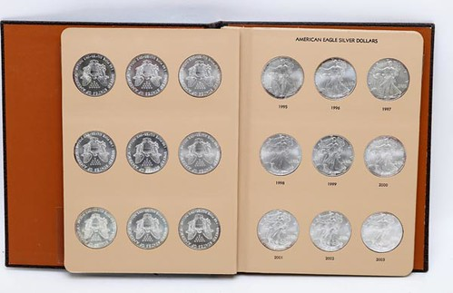 American Eagle Silver Dollars in Book ($420.00)