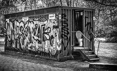 Who left the seat up? (Mister G.C.) Tags: blackandwhite bw sonya6000 sonyalpha6000 mirrorless streetphotography urbanphotography candid street monochrome photograph image urban town city park outsidetoilet publictoilet wc public lavatory bog container graffiti sony a6000 35mmf18 sel35f18 35mm primelens schwarzweiss strassenfotografie berlin germany europe