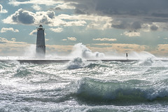 White Light (Aaron Springer) Tags: michigan northernmichigan lakemichigan thegreatlakes frankfortnorthbreakwater lighthouse pier waves weather storm gale outdoor nature waterscape