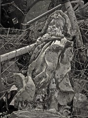 Sleeping Angel (Sea Moon) Tags: figurine plaster concrete statuary abandoned trash weathered decor foundobject