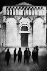 Untitled (Lucretia My Reflection) Tags: lensbaby sweet50 tiltlens selectivefocus blur bokeh seeinanewway street streetphotography shadow shades texture city cityscape blackandwhite bw surreal surrealphoto haunting creepy pietrasanta church marble whitemarble square