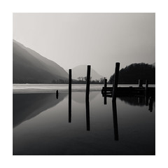 Three Sticks (LorenzoBPhoto) Tags: landscape water waterscape lake switzerland italy fineart longexposure winter photography blackandwhite bnw monochrome monochromatic monocromo biancoenero mountains hill reflections pole travel discover outdoor