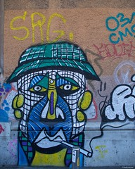 IMGP2338 Face on the wall (Claudio e Lucia Images around the world) Tags: stazione porta genova milano railway station pentax pentaxkp pentax1850 pentaxart pentaxlens pentaxcamera street art murales graffiti wall painted