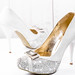 Beautiful wedding shoes with heels on white background
