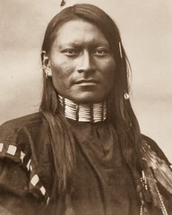 """""""Red-Armed Panther,"""" Cheyenne Scout, Fort Keogh, Montana (ca. 1879).  Photo by L.A. Huffman. (lhboudreau) Tags: portrait vintagephoto vintagephotograph northamericanindian nativeamerican nativeamericans americanindian americanindians indianscout monochrome blackandwhite blackwhite feather scout cheyennescout studioportrait cheyenne northerncheyenne redarmedpanther redsleeve shoulderdecoration earing choker hairpipechoker montana 1879 lahuffman huffman earring"""