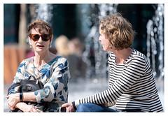 Conversation at the fountain (leo.roos) Tags: woman women vrouw fontein fountain conversation gesprek denhaag annavanbuerenplein thehague a7iii sonyfe100400mmf4556gmoss sel100400gm sonyfe1004004556 darosa leoroos