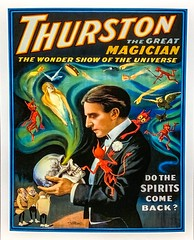 """Thurston, the Great Magician: The Wonder Show of the Universe.""  Color Poster by the Strobridge Litho Co. (1915).  Do The Spirits Come Back? (lhboudreau) Tags: prestidigitation wizardry sorcery sleightofhand magic magician conjurer conjuring illusionist illusionists 1915 artofconjuring magictricks featsofmagic magicalfeats stageillusions illusions illusion illustration illustrations thurston howardthurston stagemagician kingofkards stagemagic poster colorposter lithograph lithographic wondershowoftheuniverse spirit spirits devil devils reddevil reddevils skull talkingtoaskull strobridge strobridgelithoco"