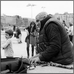 Musician with dancing boy_Rolleiflex 3.5B (ksadjina) Tags: 12min 6x6 bilbao kodak100tmax nikonsupercoolscan9000ed rodinal rolleiflex35b semanasanta silverfast spain analog blackwhite film musician scan