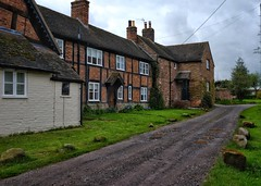 Shropshire Cottages. (margaretgeatches) Tags: village cloudy clouds countryside cottages steps porch slateroofs stonebuilt patterns brick halftimbered traditional rainyday puddles lane eatonmascott shropshire