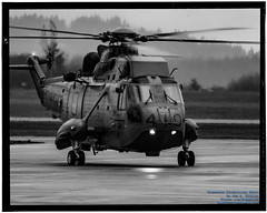 A RETURNING SEA KING IN KODAK MONOCHROME (AvgeekJoe) Tags: 12410 443cityofnewwestministermaritimehelicoptersquadron 443maritimehelicoptersquadron 443squadron 61245 bw blackwhite blackandwhite britishcolumbia ch124 ch124seaking ch124a ch124aseaking cyyj canada canadianarmedforces d5300 dslr helicopter importedkeywordtags navalaviation nikon nikond5300 rcaf register12410 royalcanadianairforce saanichpeninsula seaking sikorskych124 sikorskych124seaking sikorskych124aseaking sikorskys61b sikorskyseaking tamron18400mm tamron18400mmf3563diiivchld thankyoucanada victoria victoriainternational victoriainternationalairport yyj airport cn61245 chopper rotatingwings