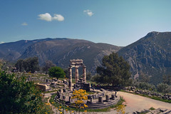 Dome of Delphi   Θόλος των Δελφών (born to be an artist) Tags: delphoi ancientgreek historic nature architecture mountains landscape trees forest domeofdelphi greek countryside greece sky blue green