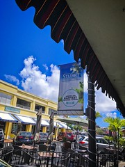 Urban Clutter with Banner (LarryJay99 ) Tags: stuartflorida urban treasurecoast smallcity banner sign flag citycenter citysnap bluesky cloudysky angle overhand clutter urbanclutter scapes urbanscape cityscape blue blueskys diagonal antled