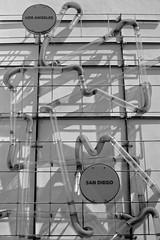 Beating Freeway Traffic?... (Viejito) Tags: entradadesantabárbara handsonlearning barryberkus leed taylorsyfan armstrongassociates donerickson mec flowersassociates montecitobanktrust abdesignstudio jmpe vanattaassociates marborg moxi dick dickwolf wolfmuseumofexplorationinnovation stevehinkley jilllevinson rchriskroes childrensmuseum stem core helmet hard hat hardhat santabarbara california usa unitedstates statestreet canons100 canon powershot s100 geotagged geo:lat=34413334 geo:lon=119691701 america funkzone reflection curves debraannnesbit innovation exploration museum musée museo science technology interactive bw monochrome blackwhite blackandwhite losangeles sandiego tubes
