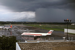 al15025cr (George Hamlin) Tags: ohio port columbus international airport cmh twa trans world airlines mcdonnell douglas md80 n9407r dark storm clouds heavy downpour northwest airbs a320 aircraft airliner airplane narrowbody single aisle trees grass sky foreboding photo decor george hamlin photography