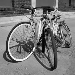 untitled (kaumpphoto) Tags: rolleiflex 120 tlr ilford bw black white street urban city bike spoke wheel rim round lines wire basket cloth thread minneapolis bicycle handle tired tread