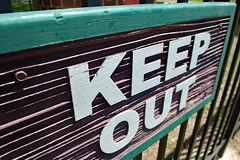 Keep Out Sign. (dccradio) Tags: lumberton nc northcarolina robesoncounty outdoor outdoors outside sign words text keepout wood wooden woodsign brown green white fence metalfence april spring springtime saturday saturdayafternoon goodafternoon afternoon nikon d40 dslr northeastpark park citypark penningtonathleticcomplex raymondbpenningtonathleticcomplex