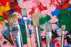 Five worn out brushes of different sizes on the colorful pink palette (MichaelShilyaev) Tags: paint background painter design color acrylic art wooden hobby paintbrush fair colorful tool dye abstract school atelier craft workshop create messy watercolor set old five size pink drawing red blue yellow equipment artist painting artistic canvas creativity palette pallete dirty creative used brushes brush oil green studio vintage