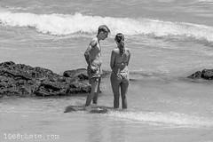 Conversation (1968photo) Tags: 1968photo fuerteventura spain canaryislands kanarieöarna travel travelphotography people peoplephotography beach beachlife spanien man woman kvinna female male bikini ocean water sea rock