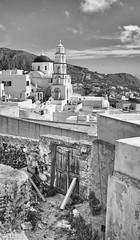 Juxtaposed b&w (Rob McC) Tags: cityscape urban greek pyrgos santorini bw blackandwhite monochrome urbandecaychurch