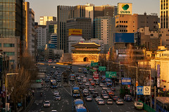 Namdaemun Golden (Scintt) Tags: sky dramatic travel tourist attraction exploration movement motion skyline cityscape city urban modern structures architecture buildings offices scintillation scintt jonchiangphotography iconic surreal epic wideangle glow light tones dusk twilight lensflare financial centre korea evening blue hour skyscrapers tall towers seoul namdaemun gate traffic lighttrail sunset tourism vehicles lines cars speed fast night road junction highway sungnyemun sony a7rii telephoto golden warm yellow