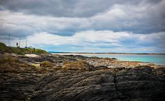 Sea shore line with massive rocks (Carl Terlak) Tags: apsc zeiss nex6 nex ilce ireland sony blue sea