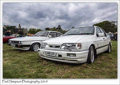 Ford Capri and Sierra (Paul Simpson Photography) Tags: ford fordcapri fordsierrasapphire cosworth nottinghamshire paulsimpsonphotography sonya77 imagesof cars carshow classiccarshow transport whitecars thoresbyhall may2019 retro carsfromthe80s carsfromthe90s sportscar fastcars sporty turbo