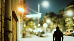 because the night (frax[be]) Tags: streetphotography street bokeh night lights blur atmosphere moody 35mm fuji city urban outdoor silhouette grain dof