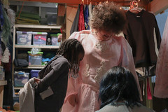Chris Cestaro, the theater manager at ALPs in Athens, Georgia, helped Ashley Gershom, a 10-year-old actress, pick out a costume on Friday, Feb. 8, 2019, as Mattilyn Johnson, a 7-year-old actress, looked on.  (Photo/Mary Mar