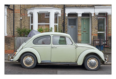 Volkswagen Beetle, South East London, England. (Joseph O'Malley64) Tags: volkswagenbeetle beetle volkswagen vw classiccar car automobile vehicle motor motorvehicle cultclassic parkedup parked static southeastlondon london england uk britain british greatbritain speedbump sleepingpoliceman residential housing homes dwellings abodes victorianbuildings thebuiltenvironment newtopography newtopographics manmadeenvironment manmadestructures buildings brickwork bricksmortar cement pointing stucco stuccowork baywindows windowbays doorways doors woodenpanelleddoors glazeddoor windows doubleglazedwindows upvcdoubleglazing upvc gradient incline wiring electricalwiring frontgardens granitekerbing tarmac wall fencing railings urban urbanlandscape architecture documentaryphotography britishdocumentaryphotography fujix fujix100t accuracyprecision