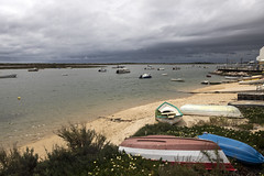 Boats in Tavira, Portugal (dckellyphoto) Tags: portugal 2019 tavira ocean water beach boats sky cloudy canon6dmarkii travel europe algarve coast boat dark
