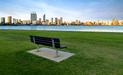 Chair and grass in the park (anekphoto) Tags: perth australia city river swan meeting western field grass green road skyline blue point foreshore sky tree bench wooden sunlight clouds landmark path cityscape traffic wide buildings twilight daylight mill afternoon chairs skyscrapers cars landscapes parks oceania benches walkways austalasia view beautiful park nature south summer natural travel brown coast