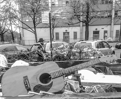This guy wants to take this old guitar and fix it, to write the most beautiful song ever written. (Capitancapitan) Tags: neury luciano merengue bachata pop rock urim y tumim el mundo gira people black white street photography manhattan nyc new york city walk iphone apple instagram