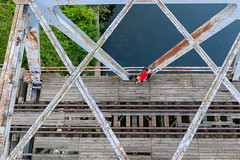 Above the bridge (piotr_szymanek) Tags: ania aniaz woman young skinny portrait outdoor drone bridge water river red dress blue fromabove rail steel landscape railway green 1k 20f 5k 50f 10k 100f 20k