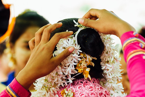 Placing Flowers in Hair at Nat Pwe Ceremony