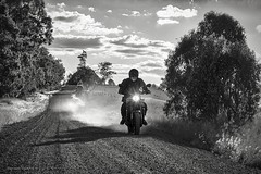 gravel road (gnarlydog) Tags: australia dirtroad monochrome motorcycle contrejour silhoutte blackandwhite manualfocus adaptedlens cmountlens canontv1650mmf14 dust backlit yamaha xsr900 rider
