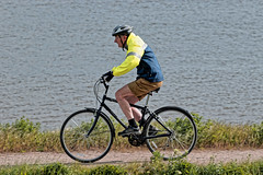 Bradley Wiggins has let himself go! (Croydon Clicker) Tags: bicycle cyclist helmet shorts bike pedal footpath pathway grass river water thames dartford greenhithe kent nikkor