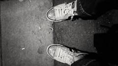 Feet at Night: No.163 (WatermelonHenry) Tags: twofeet feetatnight feet concrete converse converseallstars skyblueconverse conversepumps legs pair bw monochrome trainers allstars alllstars onestar who'sshoes twoshoes shoes denim nighttime atnight liverpool toxteth pavement pavingslab pov pointofview