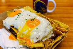 Pulled pork and fried egg nachos (garydlum) Tags: cornchips eggs friedeggs mozzarellacheese pork pulledpork canberra australiancapitalterritory australia
