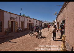 Tourism in laid back San Pedro de Atacama, Chile (jitenshaman) Tags: travel worldtravel destination destinations southamerica latinamerica chile atacama sanpedrodeatacama nortegrande desert altiplano plains mountain mountains volcano volcanoes peak tourism touristattraction desertscape arid dry brown adobe tourists licancabur tourist bike bicycle bicycles ecotourism street rural pedestrian sanpedro