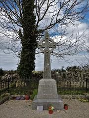 Ballyvaughn cross (Shannon O'Haire) Tags: ballyvaughn church churches clare druidstones graveyardphotography graveyards cemeteries religiousstatues religiousinstitutions cross paganireland circlegrave memorials burren ireland eire waw wildatlanticway