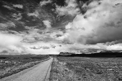 Suilven, Assynt, rain coming (Kirkbysnapper) Tags: suilven scotland lochlurgainn highlands monochrome blackandwhite skies road storm