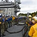 Sailors stow the aircraft barricade on the flight deck aboard USS Ronald Reagan during certifications