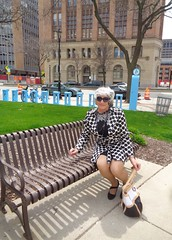 Sitting In The Park . . . (Laurette Victoria) Tags: downtown milwaukee woman laurette raincoat purse silver sunglasses