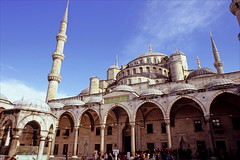 sultan ahmed mosque (Ron Layters) Tags: bluemosque sultanahmedmosque sultanahmedcamii mosque dome minaret tourists script gold building sultanahmet istanbul turkey slidefilmthenscanned slide transparency fujichrome velvia leica r62 leicar62 ronlayters