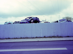 Chorzów, Poland. (wojszyca) Tags: fuji gsw680iii 6x8 120 mediumformat fujinon sw 65mm fujichrome t64 rtp tungsten slide epson v800 scrapyard car cars wreck fence junkyard