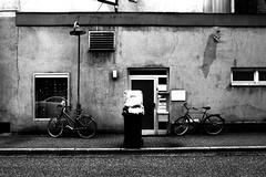Too much trash (Leica M6) (stefankamert) Tags: trash bicycle door house street windoes film analog grain tones lines noir noiretblanc blackandwhite blackwhite bw leica m6 leicam6 voigtländer ultron kodak trix sulz textures analogue