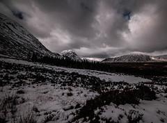 Ominous (NikNak Allen) Tags: scotland scottish highlands scottishhighlands snow winter trees mountain mountains light shadow sky cloud clouds dramatic