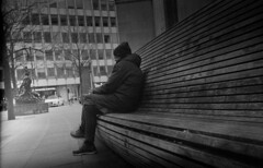Seated (4foot2) Tags: streetphoto streetshot street streetphotography candidportrate candid reportagephotography reportage people peoplewatching interestingpeople manchesterpeople manchester analogue film filmphotography 35mmfilm 35mm jupiter12 russianlens kievii ukrainiancamera киевii киев fsu formersovietunion cccp bw blackandwhite monochrome mono trix kodaktrix kodak diafine rangefinder contaxcopy 2019 fourfoottwo 4foot2 4foot2flickr 4foot2photostream